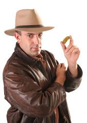 Adventurer treasure hunter with gold nugget