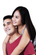 Isolated smiling young couple