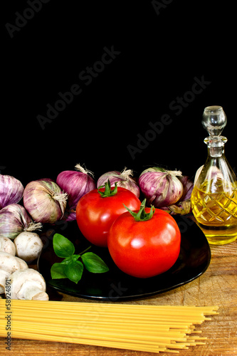 Pasta ingredients on black background italian cuisine concept