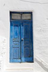 wooden blue door in greece