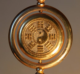 gold yin yang sign surrounded by Trigrams