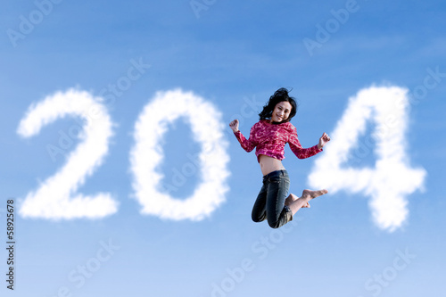 Woman jumping with new year 2014