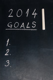 2014 goals words written on the chalkboard