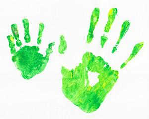 Grüne Abdrücke von Händen