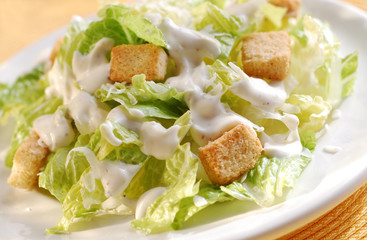 Fresh healthy Caesar salad closeup.