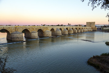 Sunset in the Roman bridge the river Guadalquivir in Cordoba