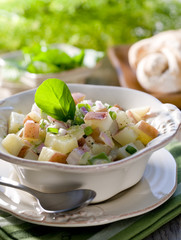 Closeup of a healthy red potato salad.