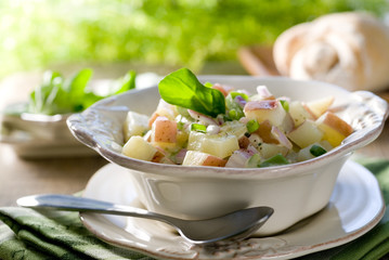 Closeup of a red potato salad.
