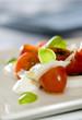 Caprese salad with tomatoes, basil and mozzarella.
