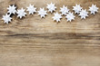 Paper stars on wooden rough background. Copy space