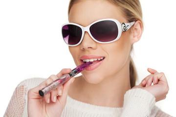 Young Woman Smokin Electic Cigarette