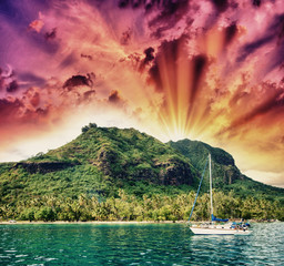 Wonderful dream island in Polynesia with small boat and Ocean