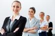Four businesswomen standing in row