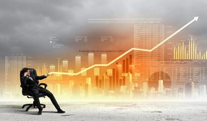 Businessman pulling graph