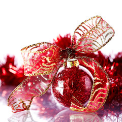 New Year's red ball with a bow and New Year's tinsel