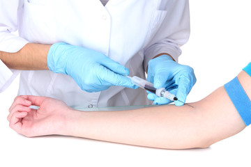 Nurse takes blood from the veins isolated on white