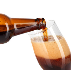 Beer poured into glass isolated on white