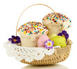 Easter cakes with eggs in wicker basket isolated on white