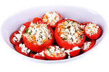 Stuffed tomatoes in bowl isolated on white