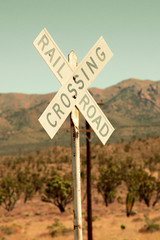 Railroad crossing sign in the desert