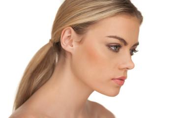 Profile portrait of a serious blond woman
