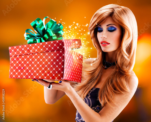 Beautiful sexy  woman with a christmas gift