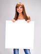 Young smiling woman holds white big banner