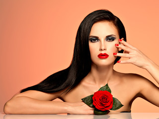 beautiful woman with  bright fashion makeup and red nails.