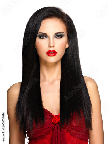 Portrait of  the beautiful woman with  black hairs and red lips