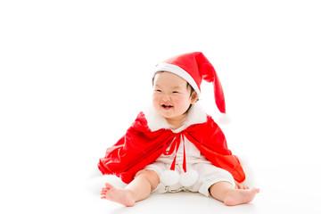asian baby wearing santa costume on white background