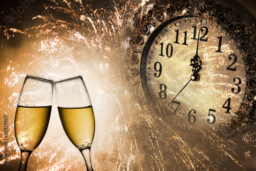 New Year's at midnight with champagne glasses - 58939867