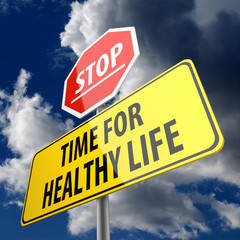 Time For Healthy Life words on Road Sign and Stop Sign