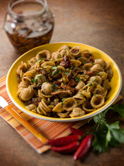 integral orecchiette with dried tomatoes, selective focus