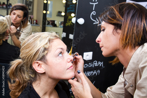 Make-up artist  applying eyebrow make-up