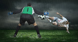 Two Football players in action under rain outdoors