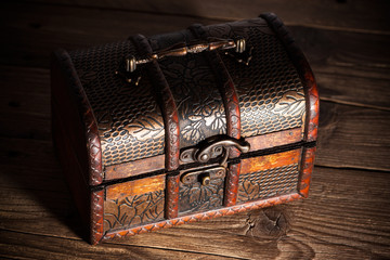 Treasure chest on wooden background