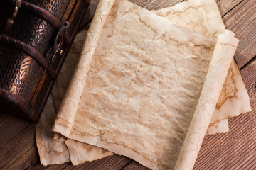 old paper on wood background with vintage chest