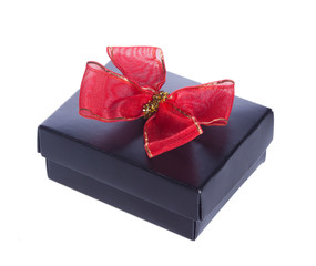 opened black gift box with red bow on white background