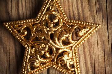 golden christmas star on wooden background