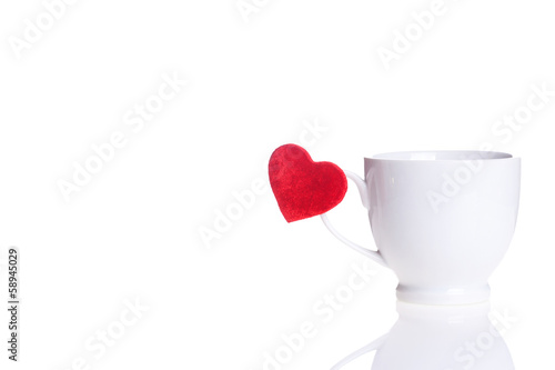 white cup with red heart on handle