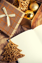 open book with christmas decoration on wooden background