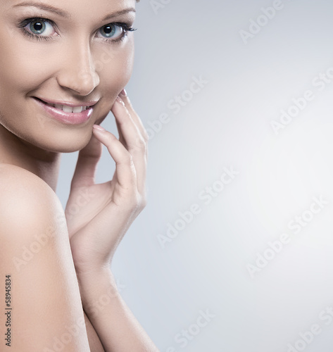 Natural looking woman is happy about her beauty