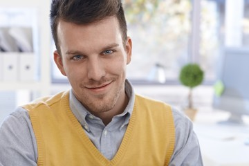 Closeup portrait of confident young man smiling