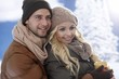 Loving couple embracing at wintertime