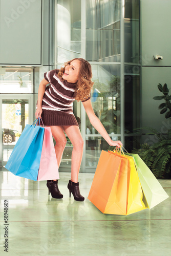happy shopping mall colorful bags legs