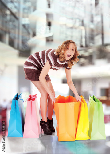 happy shopping mall colorful bags surprised