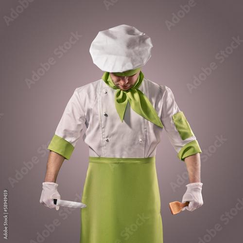 Leinwandbild Motiv chef with knife and kitchen spatula