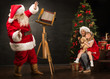 Santa Claus taking picture of family - cheerful woman with her d