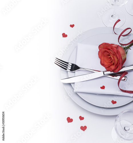 Restaurant table set for Valentines with rose