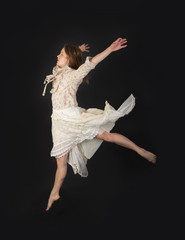 jumping girl in a dress